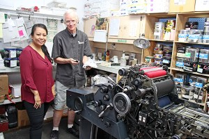 Ink Spot owner Marynel Valenzuela and press operator Don Newhouse.