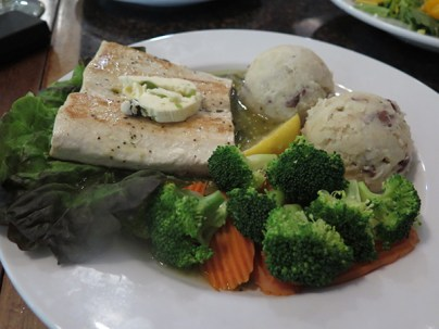 Tomatillo Fresh Fish. This super fresh fish is marinated and served over tomatillo sauce, bringing a rare spicy and tangy South of the Border flavor. Served with fresh steamed veggies and the signature garlic red mashed potatoes.