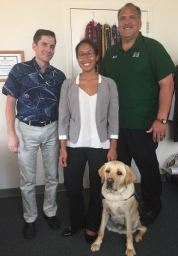 Ollie poses with Prosecuting Attorney Justin Kollar, left, Deputy Prosecuting Attorney Joanne Sheng and Mayor Bernard Carvalho Jr.