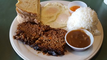 The Meatloaf and Eggs, served with brown gravy and steamed rice.