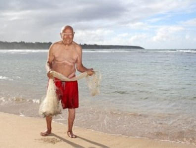 Master throw-net maker 'Uncle' Charlie Pereira has crafted close to 100 nets, and is still going. Here he is at Smith's Beach in Anahola, getting ready to throw net.