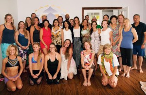 Some of the students and instructors at Bikram Yoga Kaua'i. Owner Samantha Lockwood is in the center, wearing a white shirt and a black skirt.