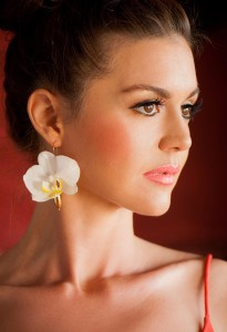 A Fleurings earring, holding a fresh orchid, created by Samantha Lockwood.