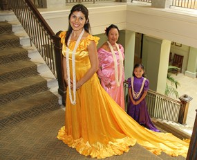 Pua Rossi-Fukino, wearing yellow, is seen here with Polei Palmeira, in pink, and Saebrie Pegeder.