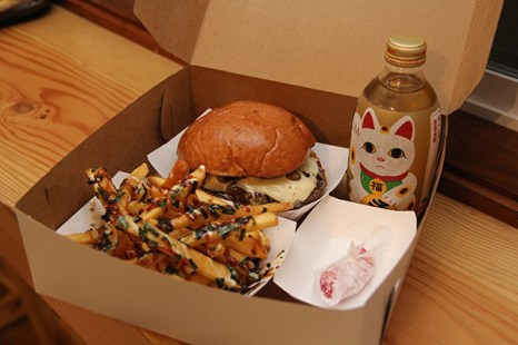 The Truffle Burger (truffle aioli, sautéed mushrooms and Swiss cheese) served in a bento burger box, with furikake fries, mochi and Lucky Cat soda.