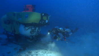 Diver, lead author R Pyle and HURL's submersible explore deep reefs. Photo courtesy of Robert K. Whitton/UH