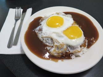 The Loco Moco was invented in Hilo, Big Island, and introduced to Kaua'i by Jonathan Ota from having tried it while away in school there. Now, no self-respecting Kaua'i breakfast menu is without its own version of Loco Moco. You can even find vegetarian options and dinner versions, but the original Kaua'i Loco Moco can still be found at Tip Top Café, with sunny side up eggs running into a thick meat gravy atop a thick grilled beef patty on a bed of rice.