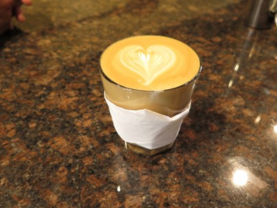 A latte made with The 42 blend, by Imua barista Samantha Dawson. The presentation in the glass cup is fantastic, a touch Steven learned during his years in Australian coffee shops.