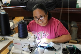 Luvimin Bechard is one of two employees sewing KaiKini bikinis. The bikinis are sold all over the world.