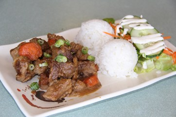 The Pork Adobo is delicious. Diced pork pieces are marinated in garlic, soy sauce and vinegar, and stewed with potatoes and carrots.