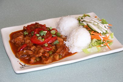 The Pork and Peas is a local favorite. It's diced pork served with green peas and red peppers in a stewed tomato sauce.