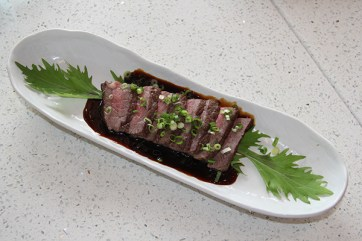 You can find this Makaweli Beef on the dinner menu. It is a French style of cooking, sous vie, which involves searing on the outside, and then cooked to medium temperature. The sauce is a teriyaki base with a slight citrus flavor to give you a range of sweet, tangy and savory all in one bite.