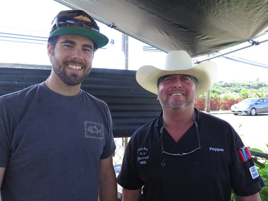 Brent Biema of the Hanalei location, and Pepper from Kapaʻa. They make sure they have a good time while they serve great BBQ.