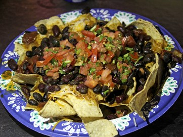 Paniolo Chili Nachos, with cheese, homemade chili and fresh salsa. Or try the Santa Maria Tri-Tip Nachos, equally mouth-watering.