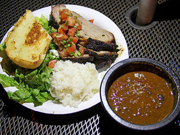 Tri-Tip Plate, served with chili and rice. In Santa Maria, traditionally the wood used to fire the barbecue pit is redwood, but out here they use a combination of readily available woods, including oak chips and java plum.