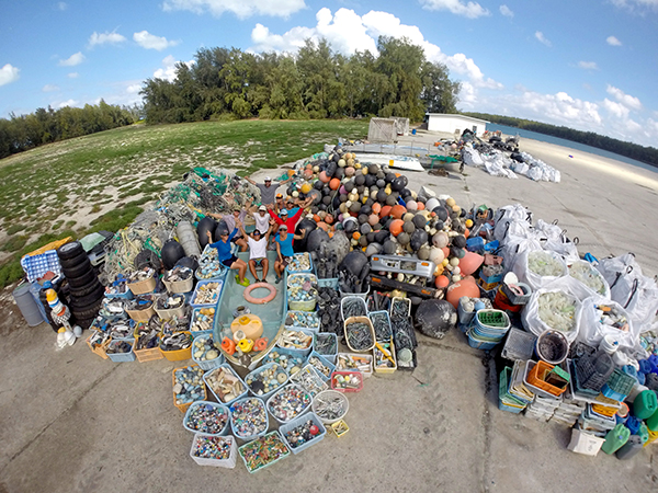 NOAA staff with all the debris cleaned up on Midway Atoll, 2017. Photo by NOAA