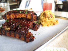 Ribs, the top seller for a reason. Dry rubbed and braised, these fall-apart ribs are glazed with a habanero honey sauce that's not too sweet and not too spicy. It comes with a scoop of Puerto Rican gandule rice and namasu garnish.