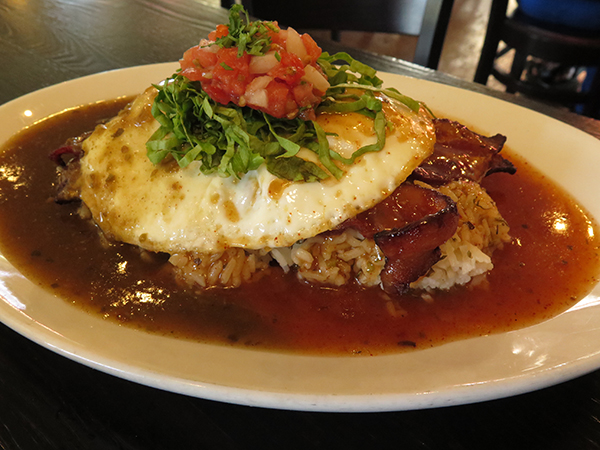 Verde's contribution to Loco Moco lore. Eggs and thick bacon atop chili-lime rice and, instead of gravy, chili sauce. You can choose red or green. Or get both, why not?