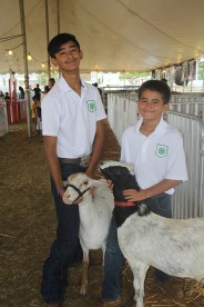 Shayden Aki, with Manno, left, and Chase Osatelli, with IPod