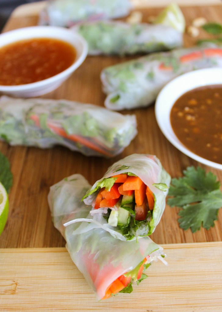cut spring roll with fish sauce and peanut sauce