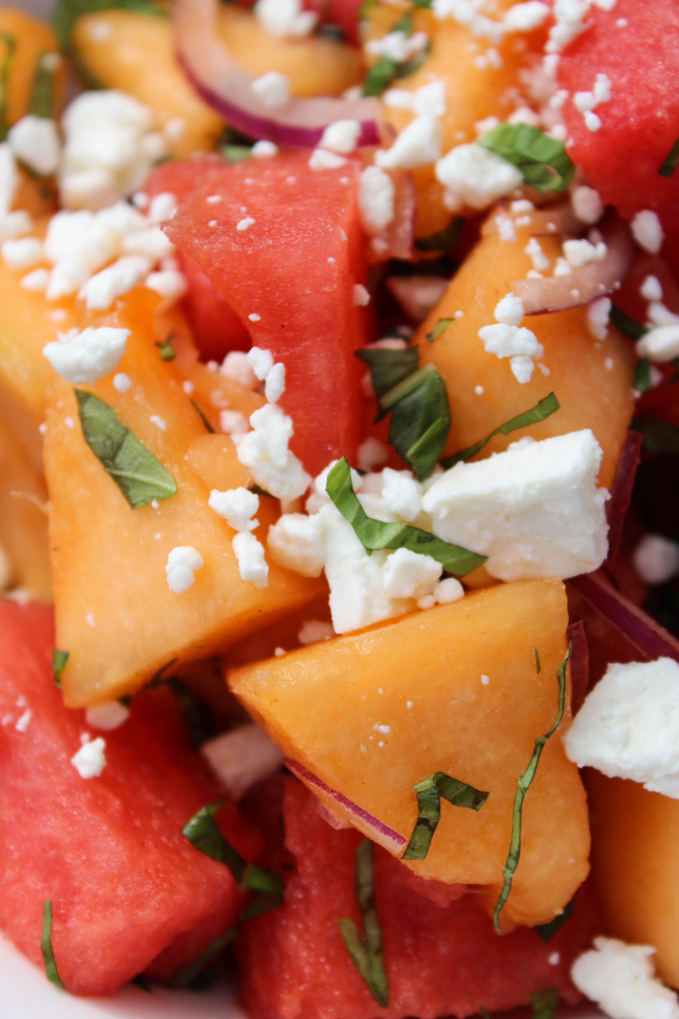 melon salad with feta and basil fork in the kitchen. Black Bedroom Furniture Sets. Home Design Ideas