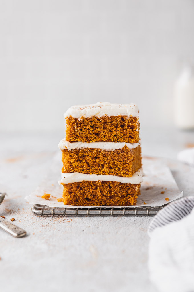 stack of pumpkin bars with cream cheese frosting