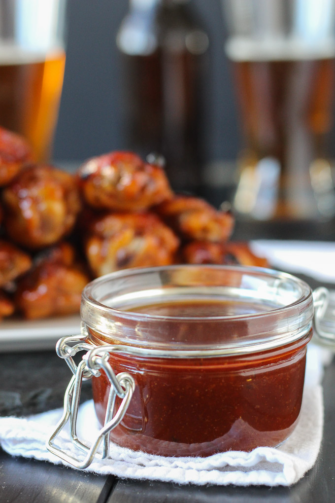 bbq sauce next to chicken wings