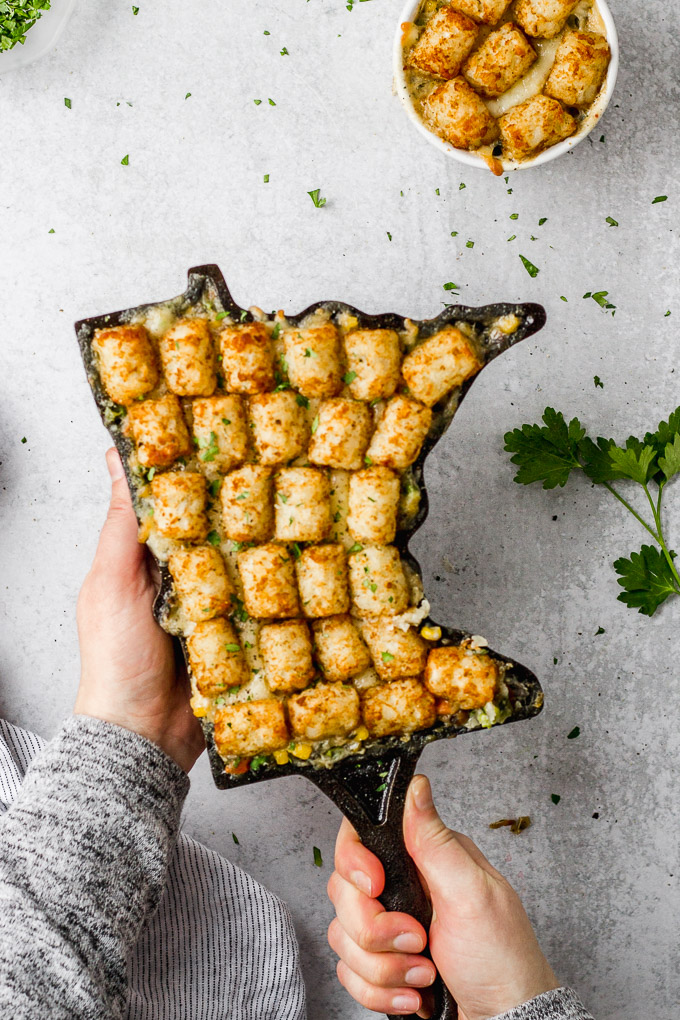vegetarian tater tot hotdish in minnesota skillet with linen by fork in the kitchen