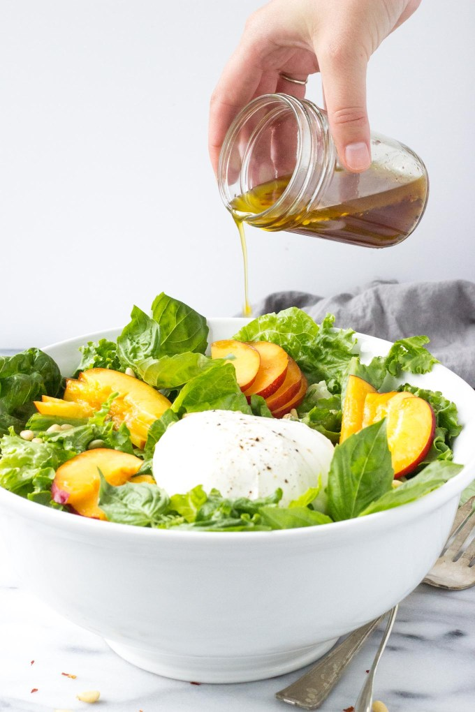 Nectarine Burrata Basil Salad - A cheese-board inspired salad with sweet nectarines, creamy burrata, fresh basil, and crunchy pine nuts tossed with a tangy, peppery dressing. | Fork in the Kitchen