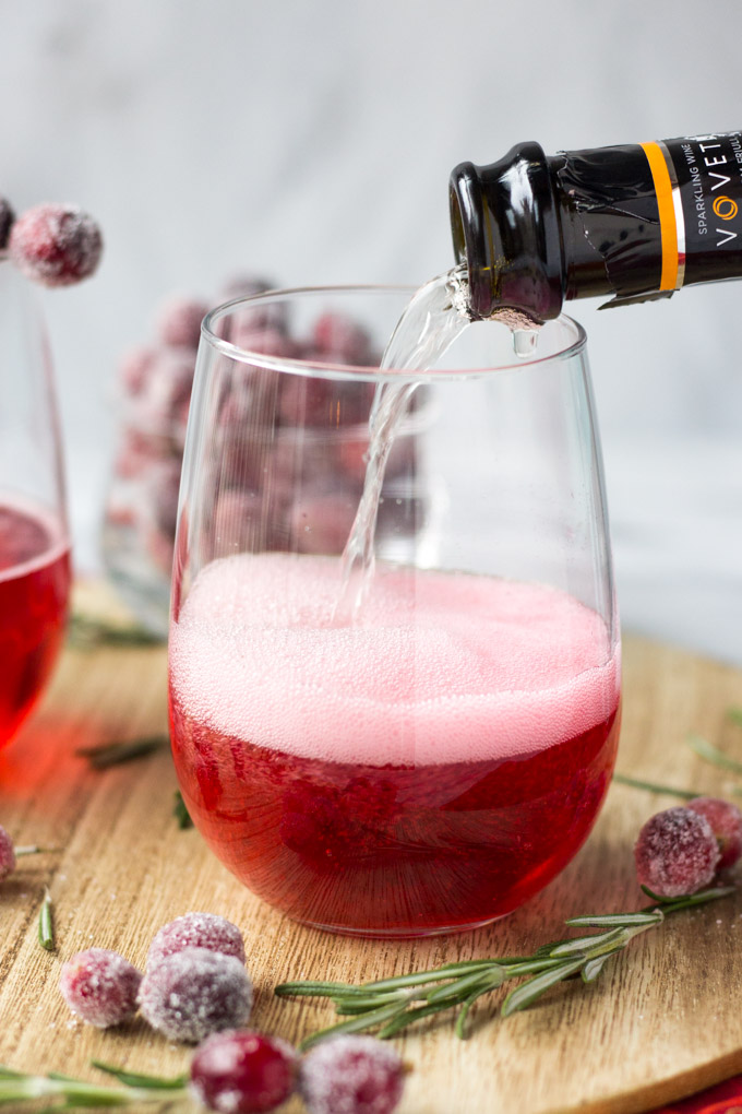 Cranberry Rosemary Prosecco - a festive holiday cocktail made with rosemary simple syrup, cranberry juice, and prosecco! | Fork in the Kitchen