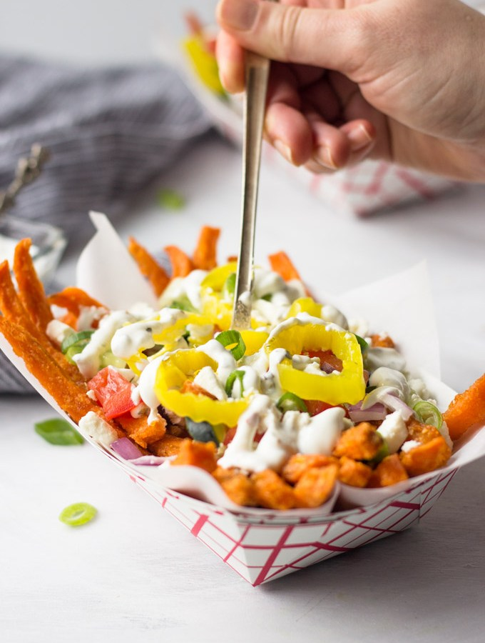 Loaded Greek Sweet Potato Fries - full of flavor, ready for the next big party or weeknight dinner!   Fork in the Kitchen