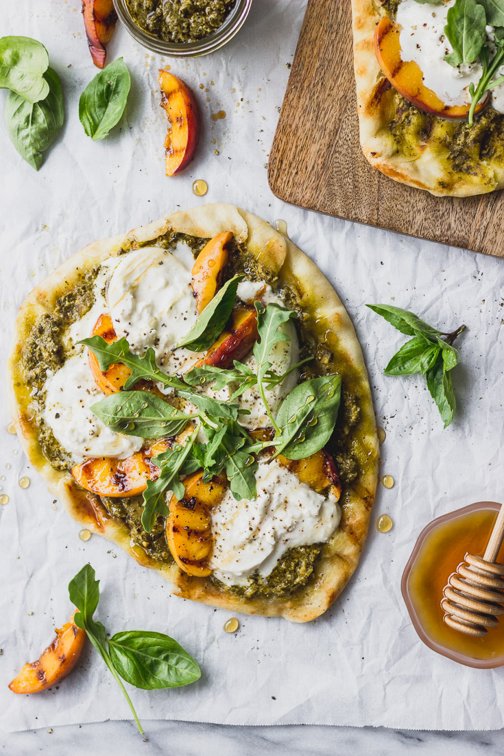 Grilled flatbread with peaches, burrata, and pesto makes for an easy weeknight dinner! #quick #summer #forkinthekitchen