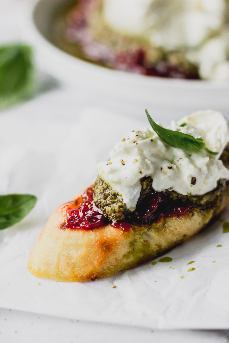 baguette with tomato jam, pesto, and burrata