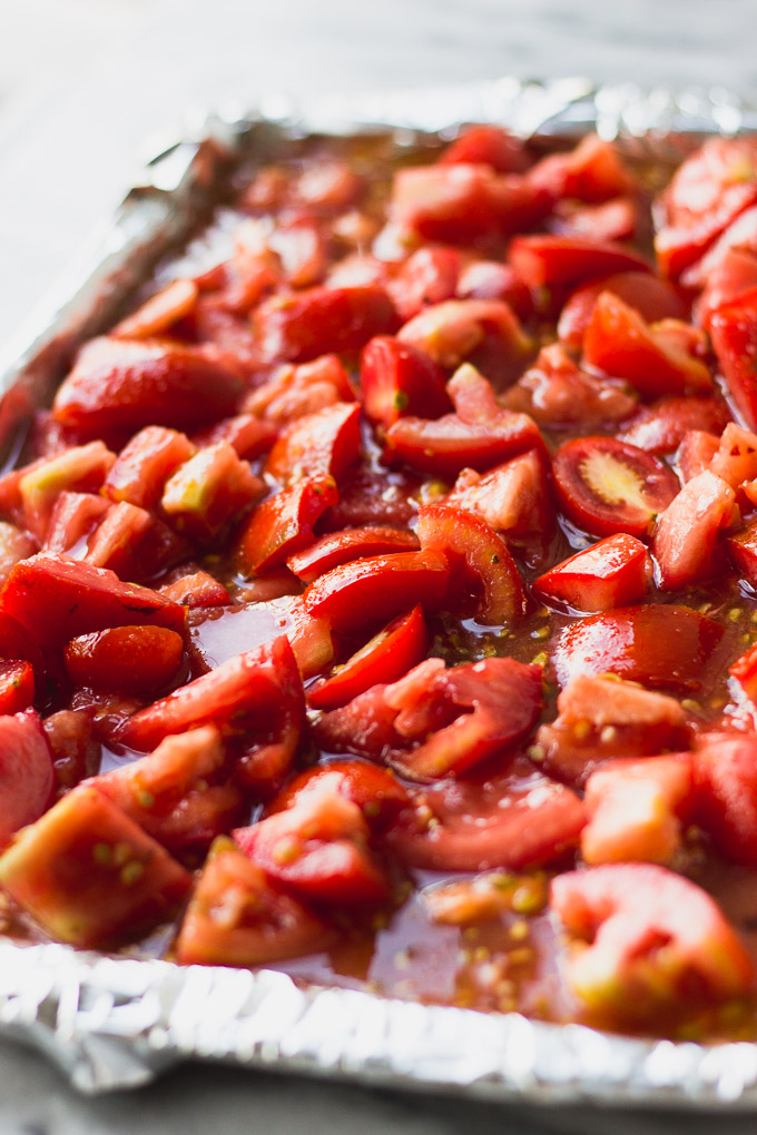 baking sheet with quartered tomatoes