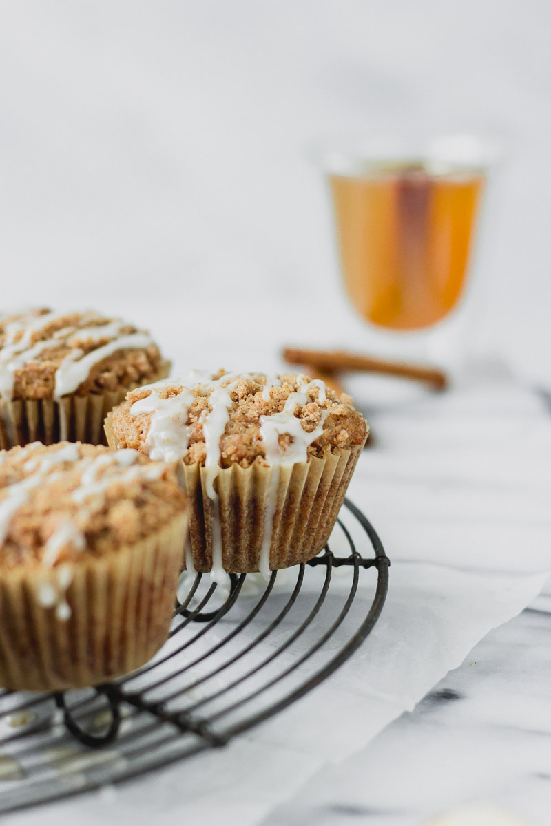 apple cider streusel muffins on cooling rack by fork in the kitchen
