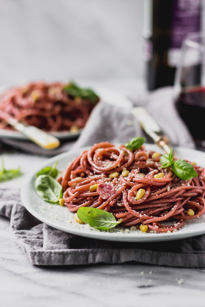 red wine spaghetti on plate with fork by fork in the kitchen
