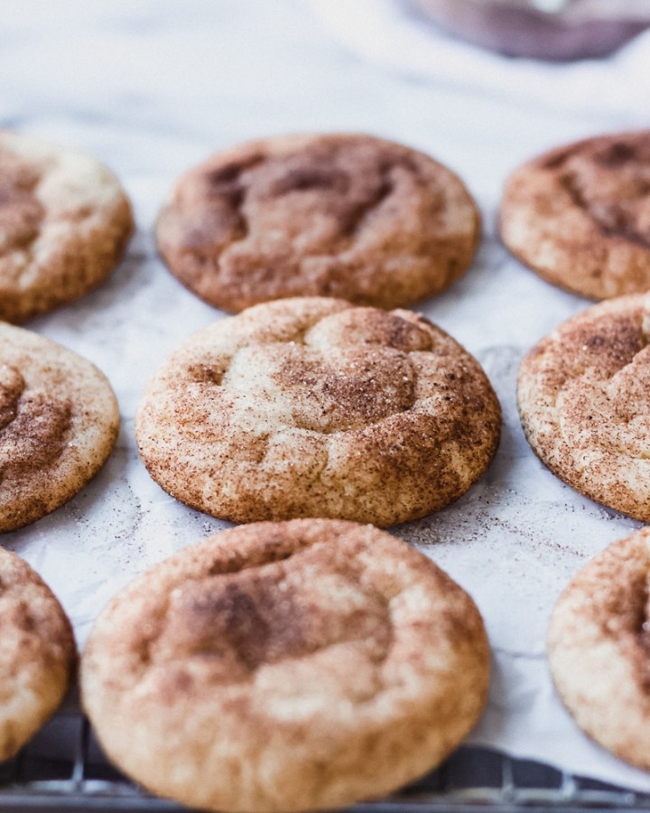 spiced snickerdoodle cookies overhead on pan by fork in the kitchen