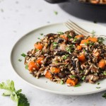 Herbed Wild Rice with Mushrooms on plate with fork by fork in the kitchen
