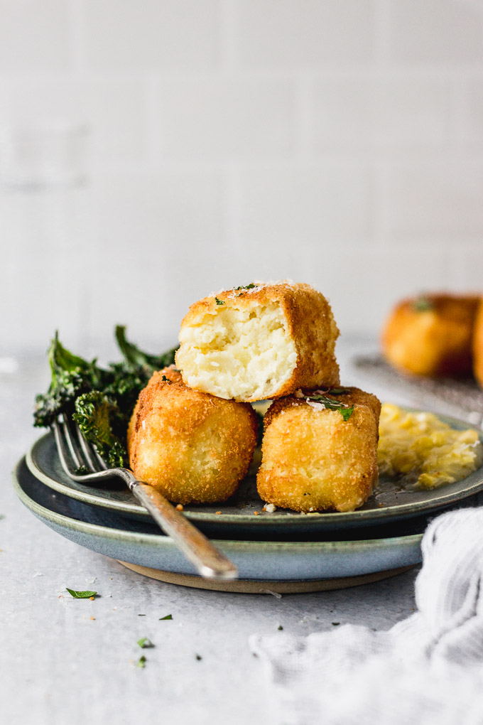 potato croquettes on plate with kale and creamed corn