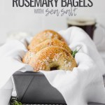 bagels in loaf pan with white linen