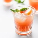 grapefruit mint cocktail in glass with ice