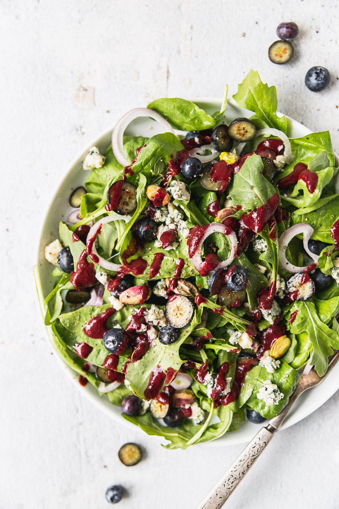 blueberry spinach salad in white bowl
