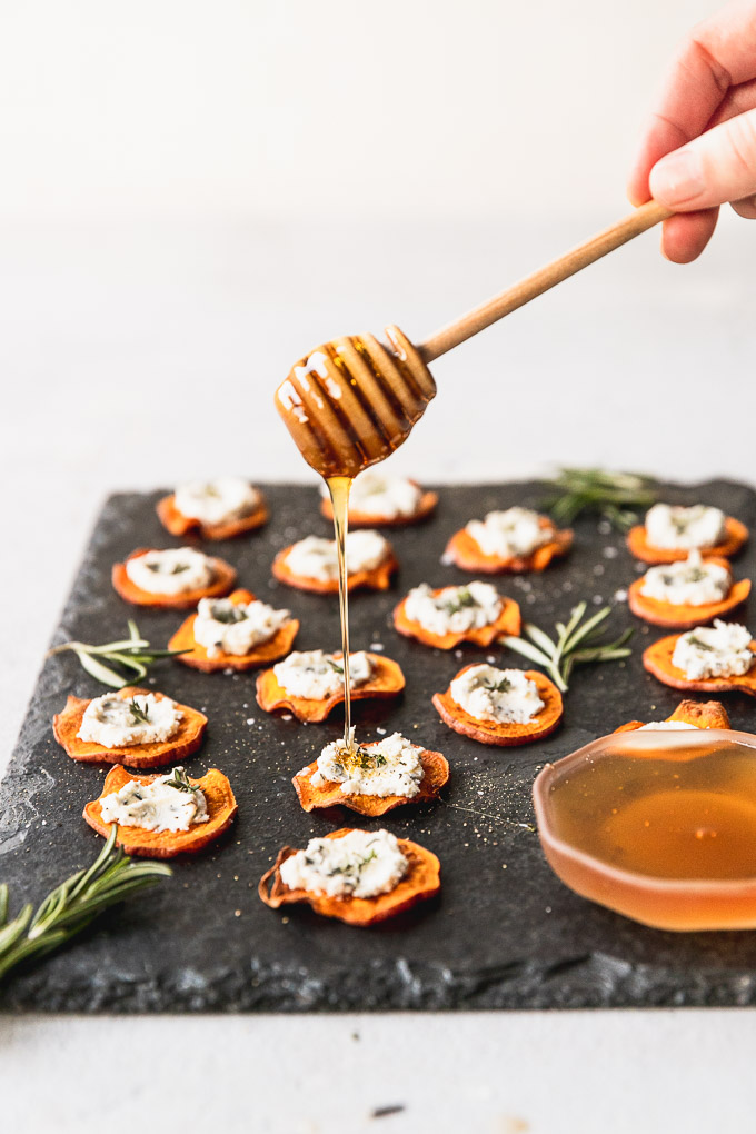 honey drizzle on herbed goat cheese