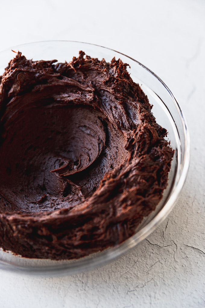 bowl of chocolate buttercream frosting