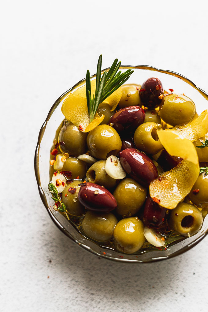 glass bowl of marinated olives up close