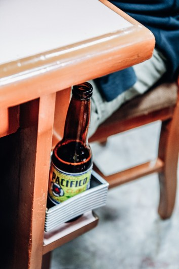 A beer in a table holder in Mexico City.