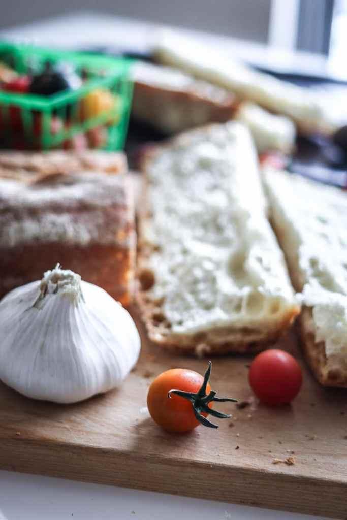 Fresh tomatoes and garlic for Caprese Ciabatta Toast, a