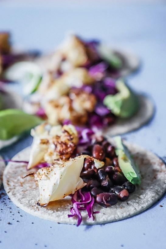 A row of three chili lime cauliflower tacos.