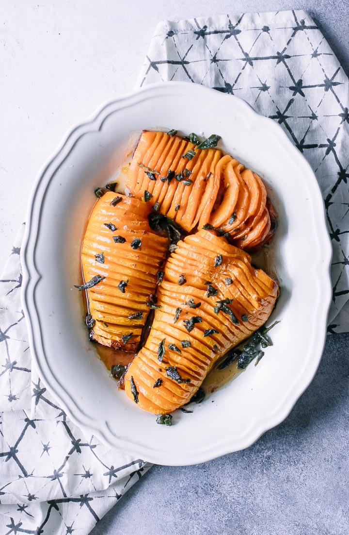 thinly sliced butternut squash on a white plate