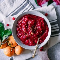 A bowl of cranberry sauce with orange zest and thyme